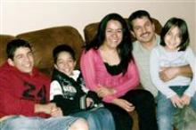 A photo of the Becerra family on a couch.